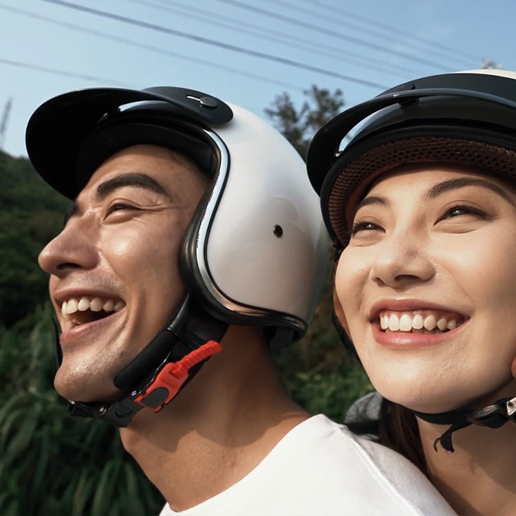 a couple riding motorcycle